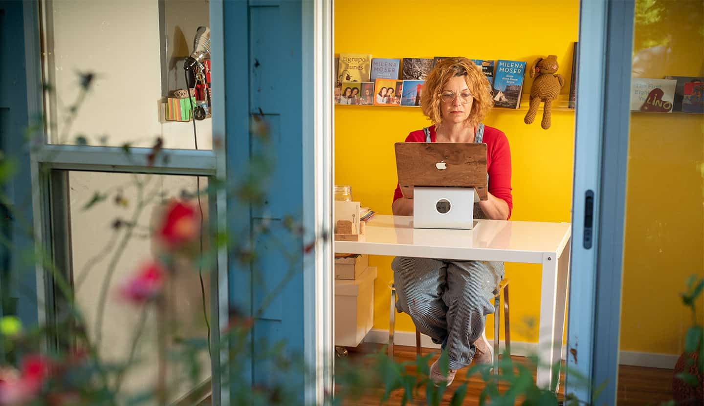 Milena Moser at her computer in her home writing studio