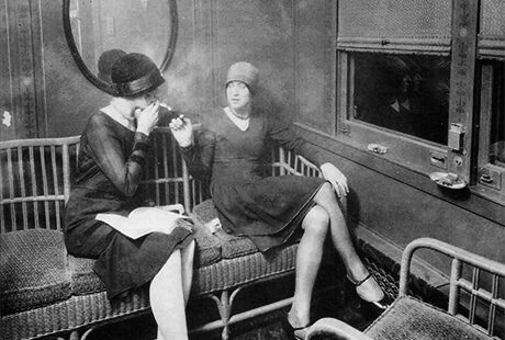 women on a train smoking and talking