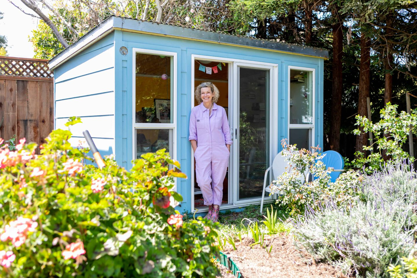 Outside her writing shed in her backyard in San Francisco